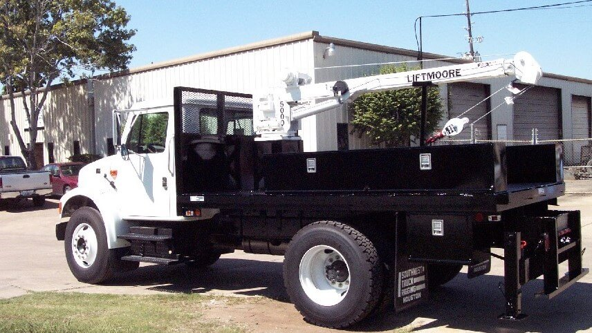 Flatbed with Liftmoore crane and RKI toolboxes
